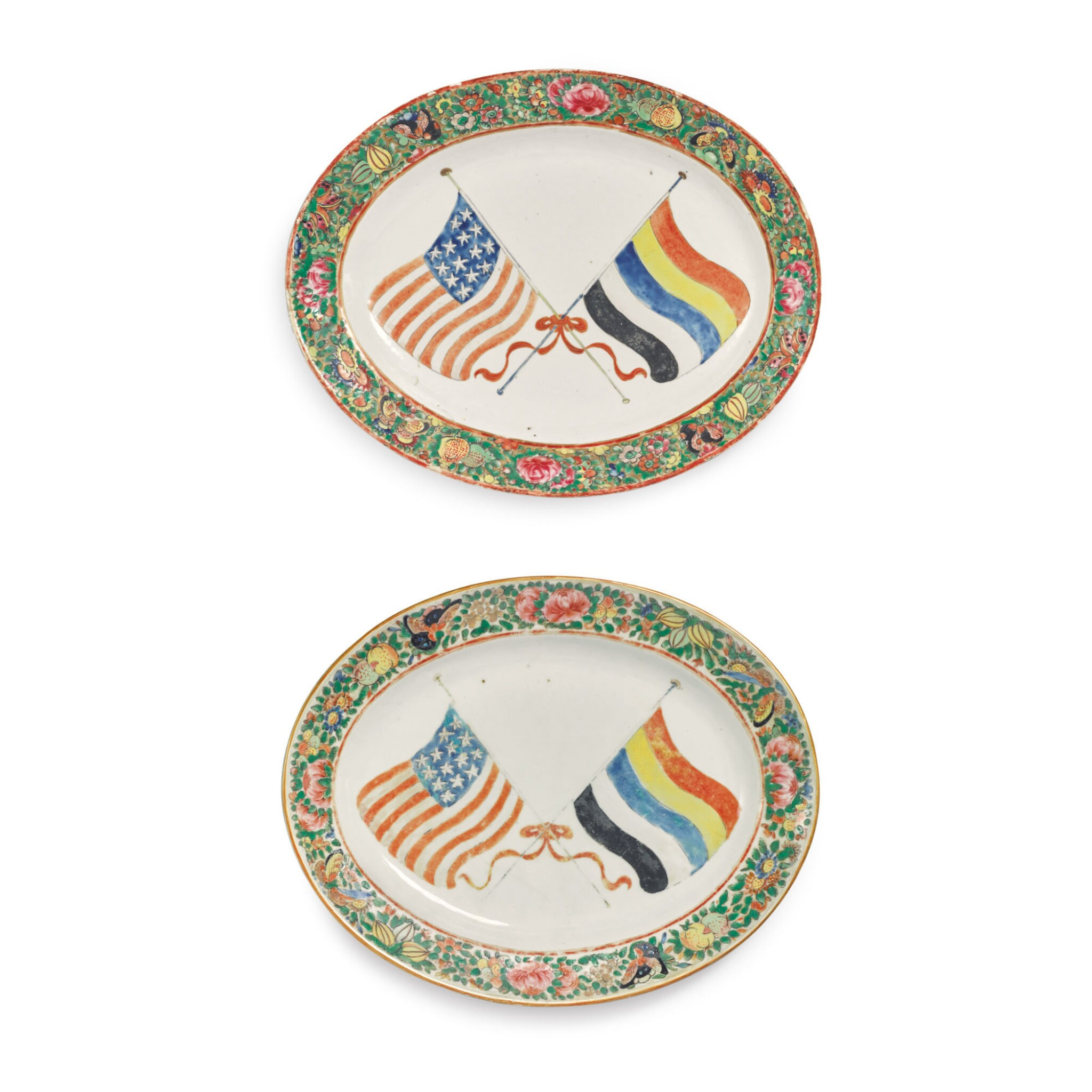 View full screen - View 1 of Lot 1886. A RARE PAIR OF CANTON FAMILLE-ROSE OVAL PLATTERS BEARING THE FLAGS OF THE UNITED STATES OF AMERICA AND THE REPUBLIC OF CHINA, REPUBLIC PERIOD, 1912-28 | 民國 1912-28年 廣彩中美國旗圖盤一對.