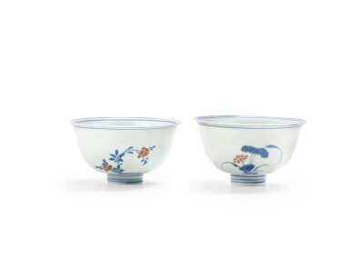 View 2. Thumbnail of Lot 62. A pair of blue and white and underglaze red 'floral' bowls Qing dynasty, Kangxi period | 清康熙 青花釉裏紅花卉紋盌一對.