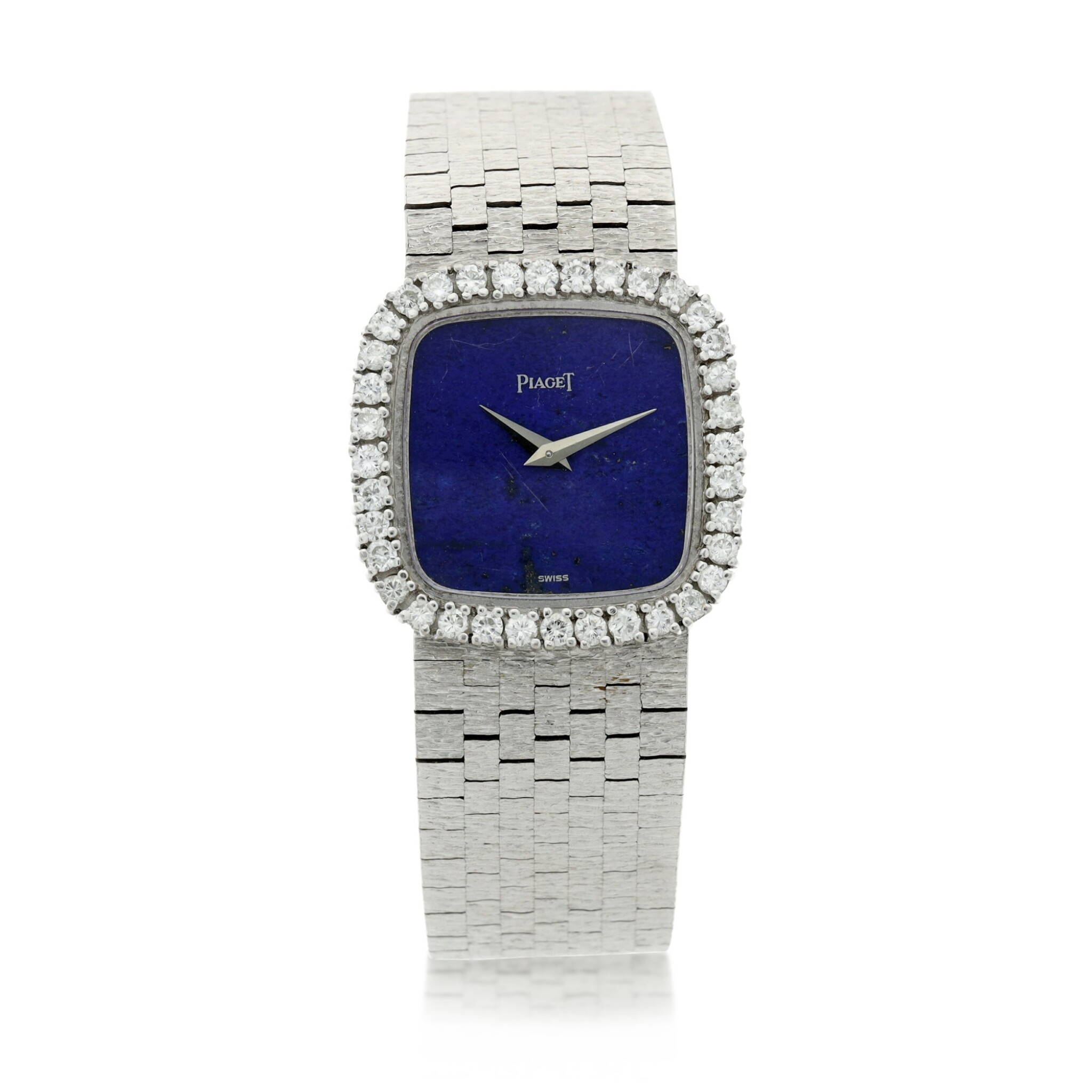 View full screen - View 1 of Lot 111. A white gold and diamond-set cushion shaped bracelet watch with lapis lazuli dial, Circa 1970.