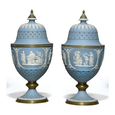 A PAIR OF WEDGWOOD THREE-COLOR JASPERWARE GILT-METAL MOUNTED VASES AND FIXED COVERS LATE 19TH CENTURY