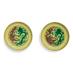 A PAIR OF GREEN AND AUBERGINE-ENAMELED YELLOW-GROUND 'DRAGON' DISHES,  KANGXI MARKS AND PERIOD
