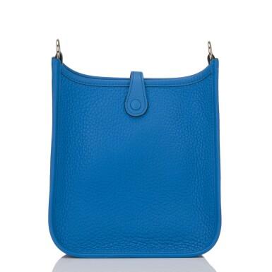 View 4. Thumbnail of Lot 17. Hermès Bleu Zanizbar Evelyne TPM of Clemence Leather with Palladium Hardware.