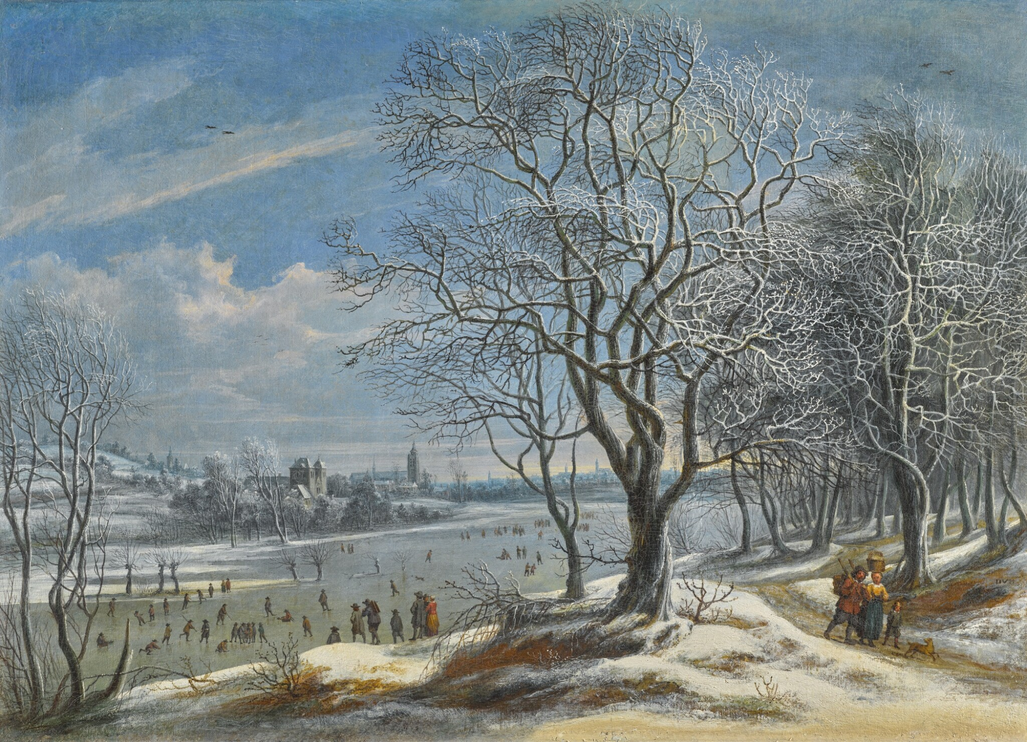 View full screen - View 1 of Lot 159. DANIËL VAN HEIL | Winter landscape and skaters with figures on a path in a wood, a town (probably Antwerp) beyond.