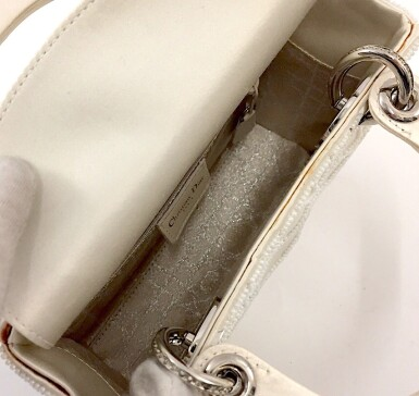 View 8. Thumbnail of Lot 750. DIOR | CREAM LADY DIOR MINI BAG IN SATIN WITH MINI PEARL BEADING CANNAGE AND CRYSTAL TRIM.