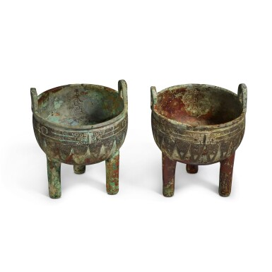 View 3. Thumbnail of Lot 1. An extremely rare pair of archaic bronze ritual food vessels (Ding), Late Shang dynasty   商末 子龔鼎一對.