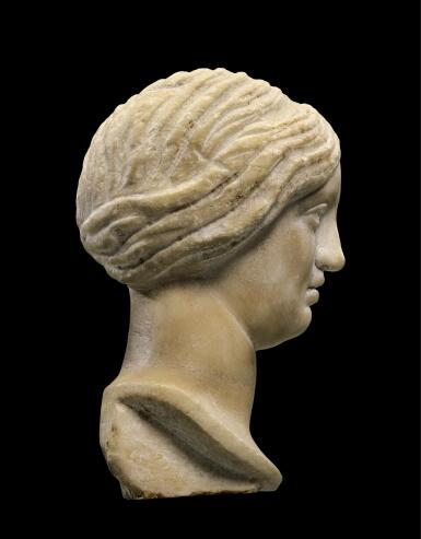 A LATE ROMAN MARBLE HEAD OF A WOMAN OR GODDESS, CIRCA 4TH CENTURY A.D.