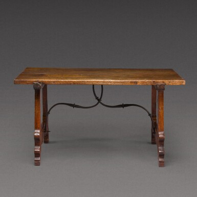 View 1. Thumbnail of Lot 176. A Spanish Baroque walnut trestle table, 17th century.