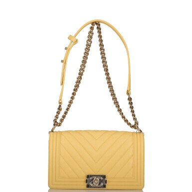 View 5. Thumbnail of Lot 98. CHANEL |  YELLOW CHEVRON OLD MEDIUM BOY BAG OF CAVIAR LEATHER WITH LIGHT GOLD TONE HARDWARE.