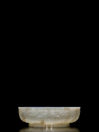 View 2. Thumbnail of Lot 62. An extremely rare inscribed archaistic celadon jade 'twin fish' basin, Mark and period of Qianlong | 清乾隆 青玉雕雙魚盤 《大清乾隆倣古》款.