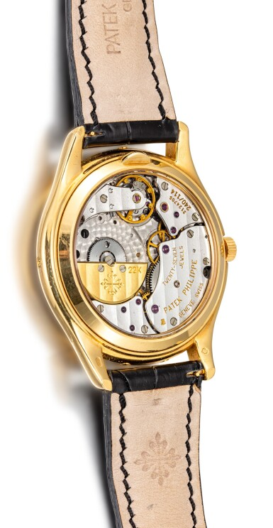 View 3. Thumbnail of Lot 4001. PATEK PHILIPPE | REFERENCE 3940, A YELLOW GOLD PERPETUAL CALENDAR WRISTWATCH WITH MOON PHASES, 24 HOURS AND LEAP YEAR INDICATION, CIRCA 2005.