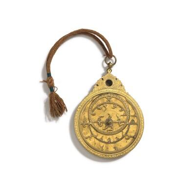 View 2. Thumbnail of Lot 67. A fine Safavid gilt-brass astrolabe made for Imam Mirza Razi al-Din Muhammad Husayni al-Mawsawi (d.1701), signed by Muhammad Husayn ibn Muhammad Baqir al-Yazdi, decorated by Muhammad Mahdi al-Yazdi, Persia, circa 1660.