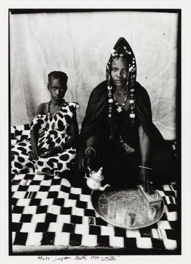 SEYDOU KEÏTA | A MOORISH HARATINE WOMAN POSING WITH HER DAUGHTER ON A CHEQUERED BLANKET, CIRCA 1949-1951