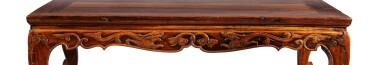 View 4. Thumbnail of Lot 92. Rare et belle table basse en huanghuali, kang Dynastie Ming, XVIIE siècle | 明十七世紀 黃花梨束腰雕螭龍紋炕桌 | A huanghuali 'kang' table, Ming Dynasty, 17th century.