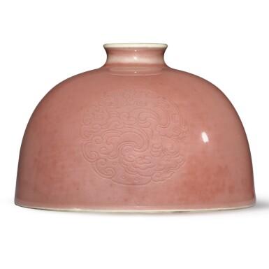 View 1. Thumbnail of Lot 136. A peachbloom-glazed 'beehive' waterpot, Kangxi mark and period   清康熙 豇豆紅釉團龍紋太白尊  《大清康熙年製》款.
