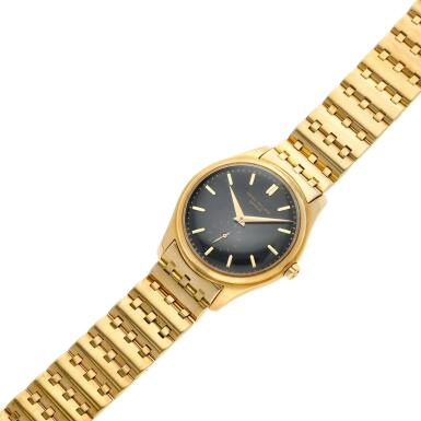 View 4. Thumbnail of Lot 227. Reference 2526  A yellow gold wristwatch with a first series black enamel dial and bracelet, Made in 1954 .