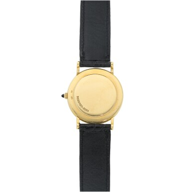 View 5. Thumbnail of Lot 204. RETAILED BY TIFFANY & CO.: A YELLOW GOLD WRISTWATCH, CIRCA 2000.