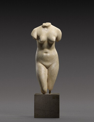 View 1. Thumbnail of Lot 39. A Hellenistic Marble Torso of the Capitoline Aphrodite, circa 2nd/1st Century B.C..