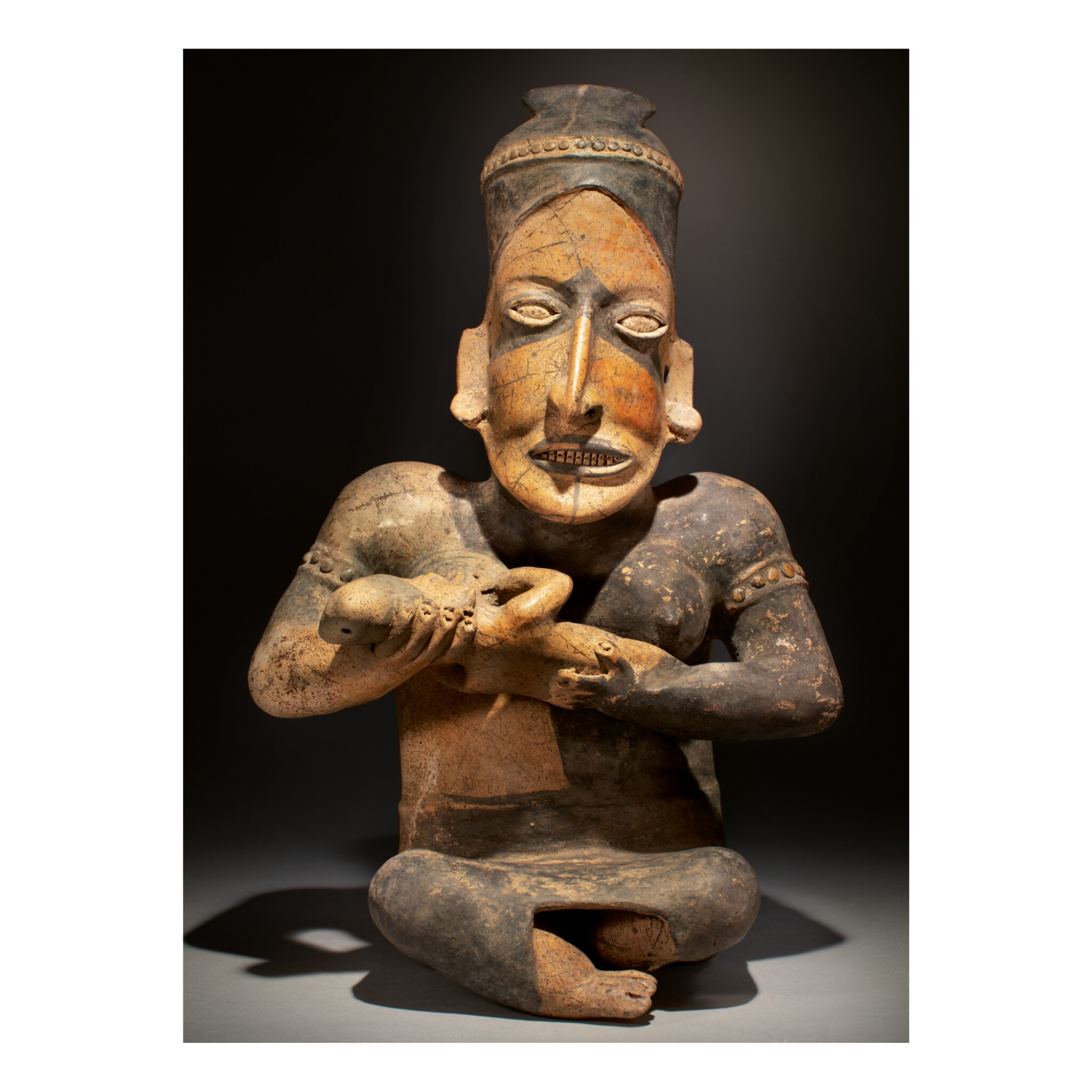 View full screen - View 1 of Lot 156. JALISCO SEATED FEMALE WITH INFANT, AMECA-ETZATLÁN STYLE PROTOCLASSIC, CIRCA 100 BC-AD 250.