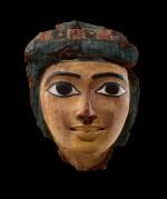 An Egyptian Polychrome Wood Mummy Mask, 21st/22nd Dynasty, 1075-716 B.C.