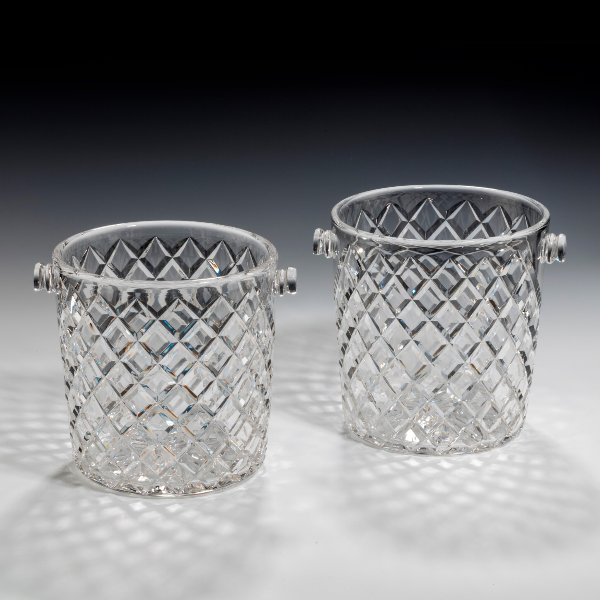 View full screen - View 1 of Lot 99. A NEAR PAIR OF GLASS CHAMPAGNE BUCKETS, 20TH CENTURY.