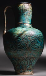A RARE AND IMPORTANT KASHAN TURQUOISE GLAZED POTTERY PITCHER, PERSIA, CIRCA 1200-20 AD
