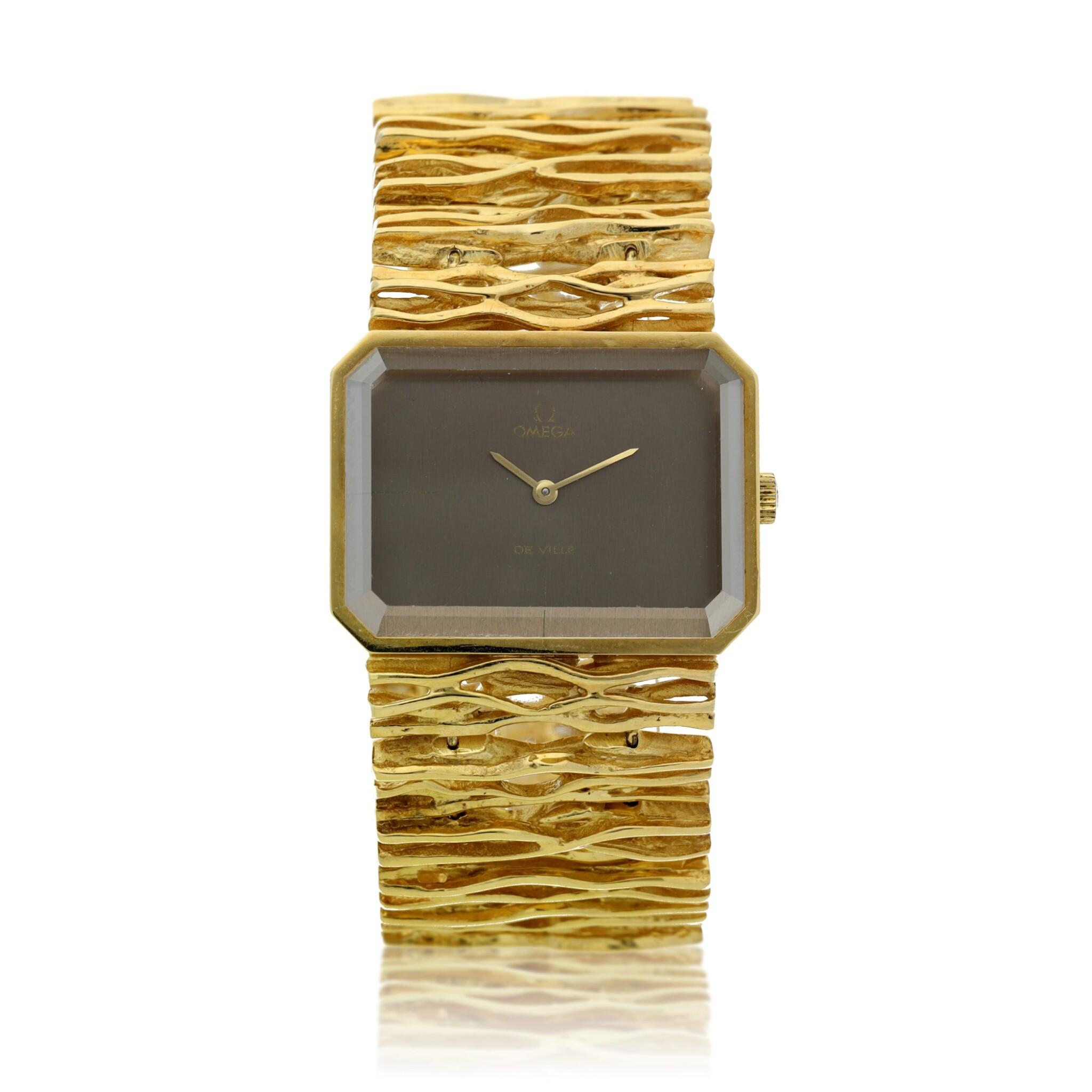 View full screen - View 1 of Lot 65. Reference 8272 De Ville Designed by Gilbert Albert: A yellow gold rectangular bracelet watch, Circa 1965.