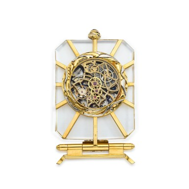 View 3. Thumbnail of Lot 8284. A two colour gold and rock crystal skeletonised perpetual calendar desk clock with moon phases and incomplete stand, Circa 1990   雙色金及白水晶鏤空萬年曆座鐘,備月相顯示及不完整底座,約1990年製.