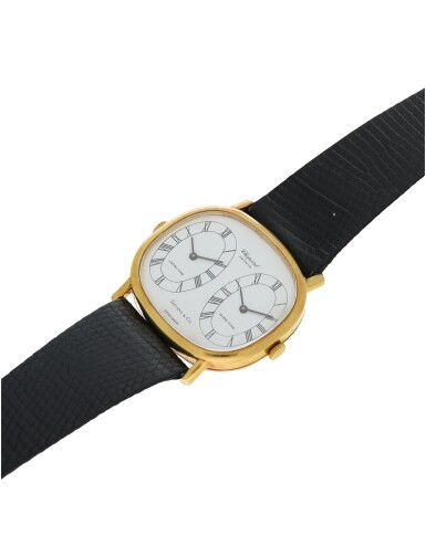 REFERENCE 2104 1 RETAILED BY TIFFANY & CO.: A YELLOW GOLD DUAL TIME WRISTWATCH, CIRCA 1990