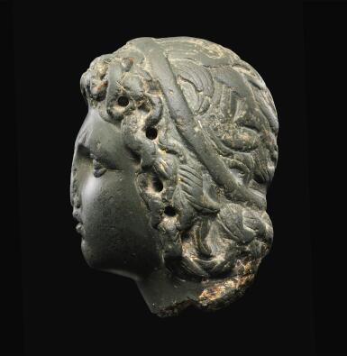 View 3. Thumbnail of Lot 26. A ROMAN GRAYWACKE HEAD OF A YOUTH, CIRCA 2ND CENTURY A.D..