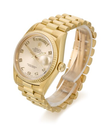 View 2. Thumbnail of Lot 6. ROLEX |  DAY-DATE, REFERENCE 18038, YELLOW GOLD WRISTWATCH WITH DAY, DATE AND BRACELET, CIRCA 1979.