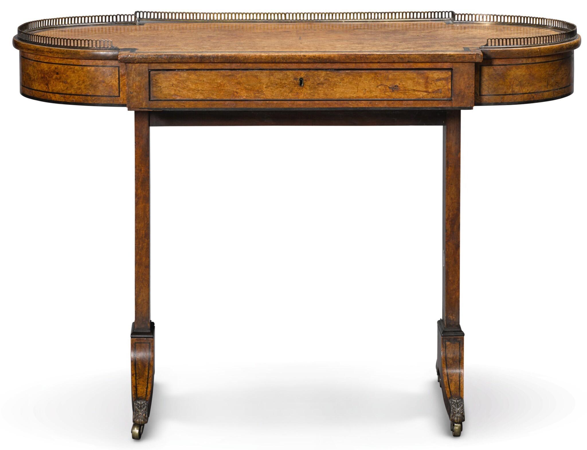 A REGENCY EBONY STRUNG BURR ELM WRITING TABLE, CIRCA 1820