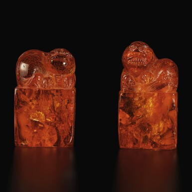 View 1. Thumbnail of Lot 179. A pair of amber 'Buddhist lion' seals, Qing dynasty, 18th century | 清十八世紀 琥珀雕瑞獸鈕印料一對.