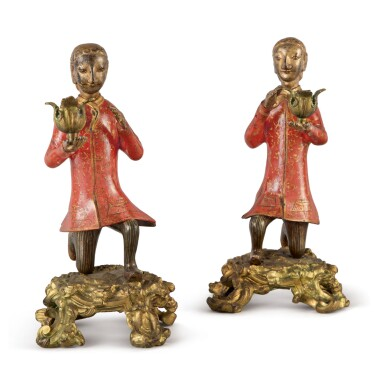 A PAIR OF QING DYNASTY GILT AND LACQUERED BRONZE ONE-LIGHT CANDELABRA IN THE FORM OF KNEELING BRONZE FIGURES OF EUROPEANS ON LOUIS XV GILT BRONZE BASES, MID-18TH CENTURY