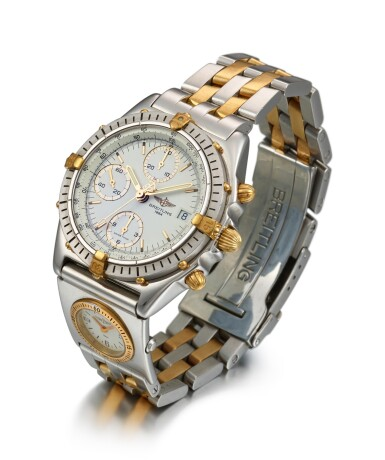 View 2. Thumbnail of Lot 8217. BREITLING | A STAINLESS STEEL AND YELLOW GOLD DUAL TIME ZONE CHRONOGRAPH WRISTWATCH WITH DATE AND BRACELET, CIRCA 2005.