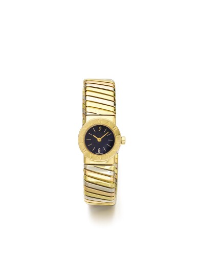 View 1. Thumbnail of Lot 43. BULGARI   REF BB 19 2T A LADY'S TRI COLOR GOLD TUBOGAS CUFF WATCH CIRCA 1985.