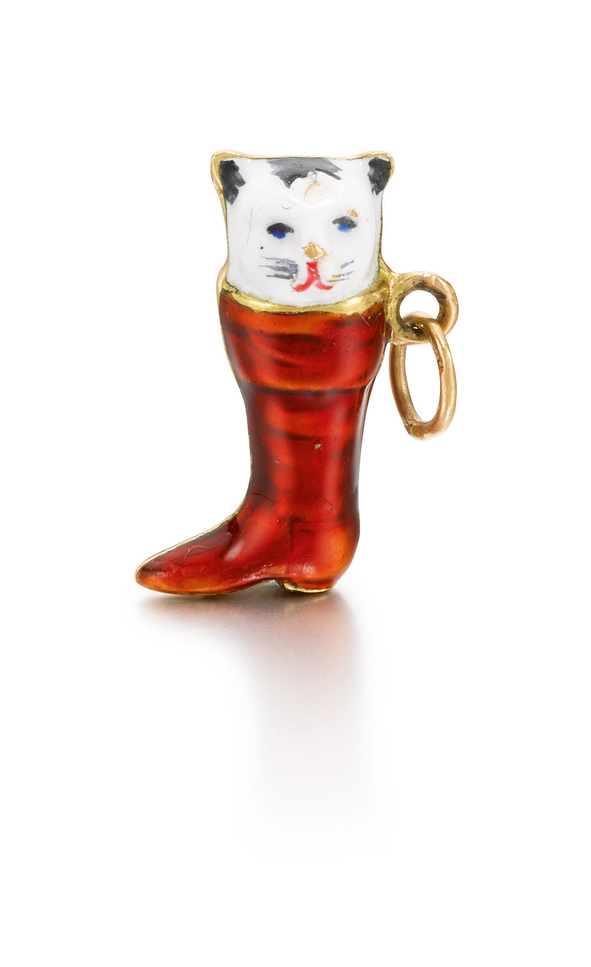 An amusing gold and enamel pendant modelled as a cat in a boot