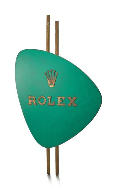 ROLEX   A GILT BRASS AND GREEN ENAMEL RETAILER'S WINDOW DISPLAY, CIRCA 1960