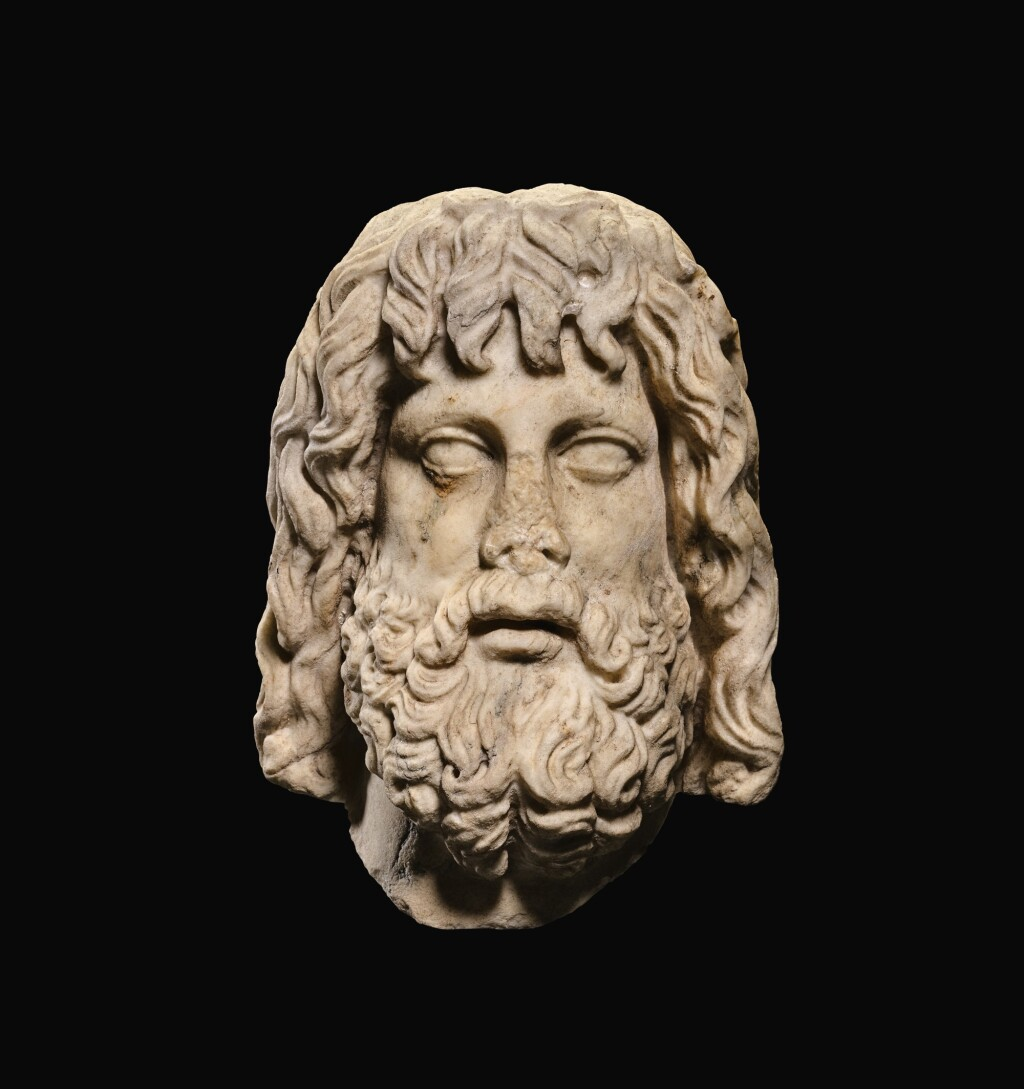 A ROMAN MARBLE HEAD OF SARAPIS, CIRCA 2ND CENTURY A.D., ON 19TH CENTURY HERM SHOULDERS