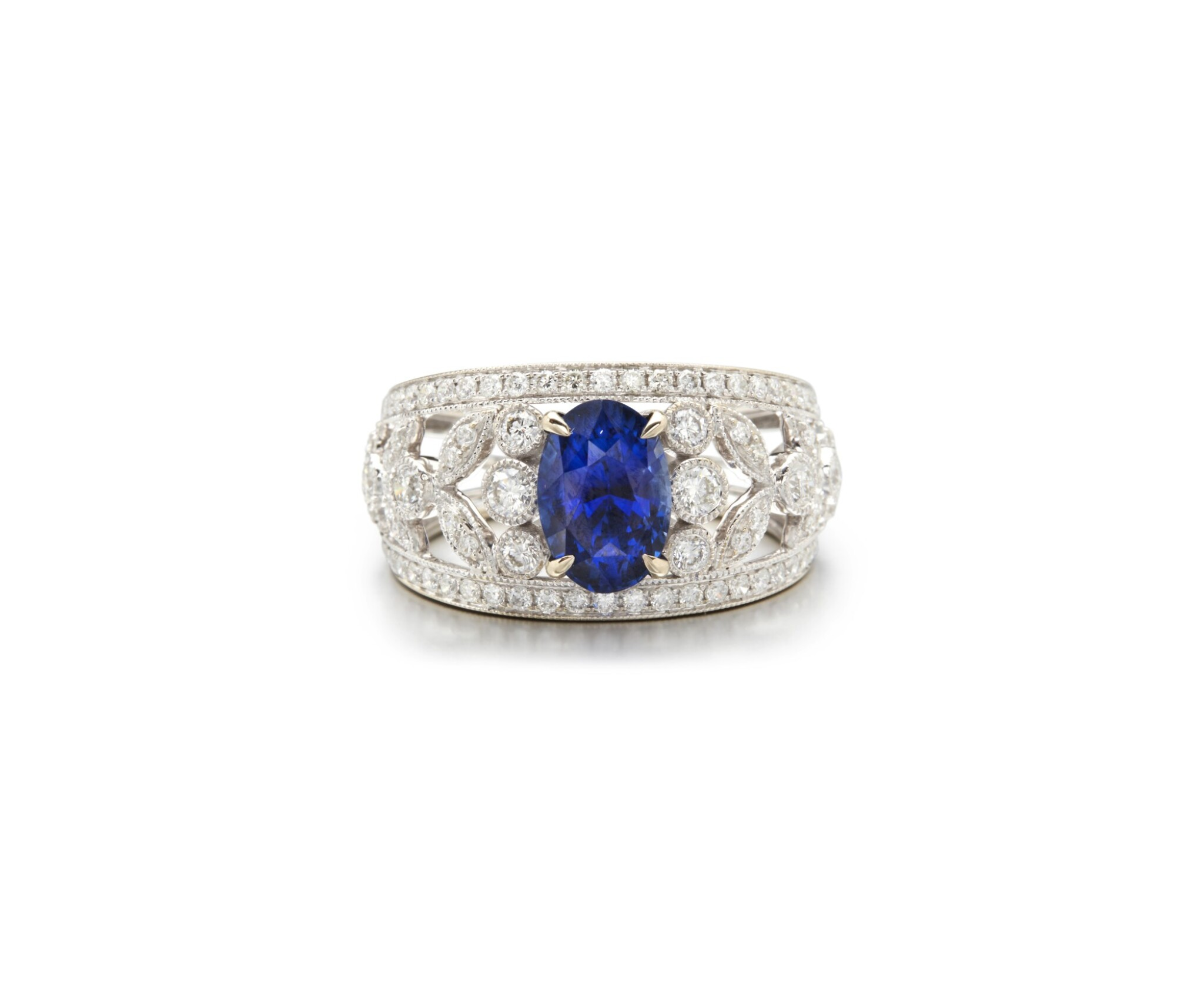 View full screen - View 1 of Lot 22. SAPPHIRE AND DIAMOND RING.