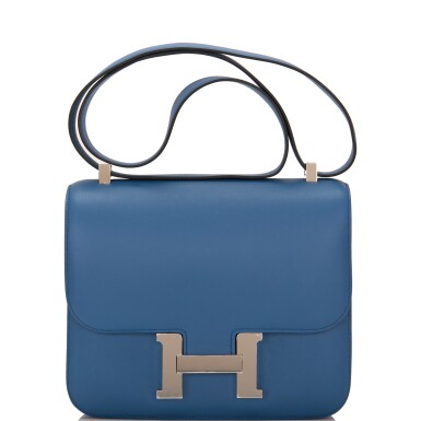 View 1. Thumbnail of Lot 18.  Hermès Bleu Agate Constance 24cm of Swift Leather with Palladium Hardware.