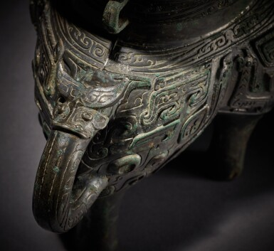 View 7. Thumbnail of Lot 12. An exceptionally rare archaic bronze ritual pouring vessel (He), Eastern Zhou dynasty, Spring and Autumn period | 東周 春秋 青銅獸面紋龍流盉.