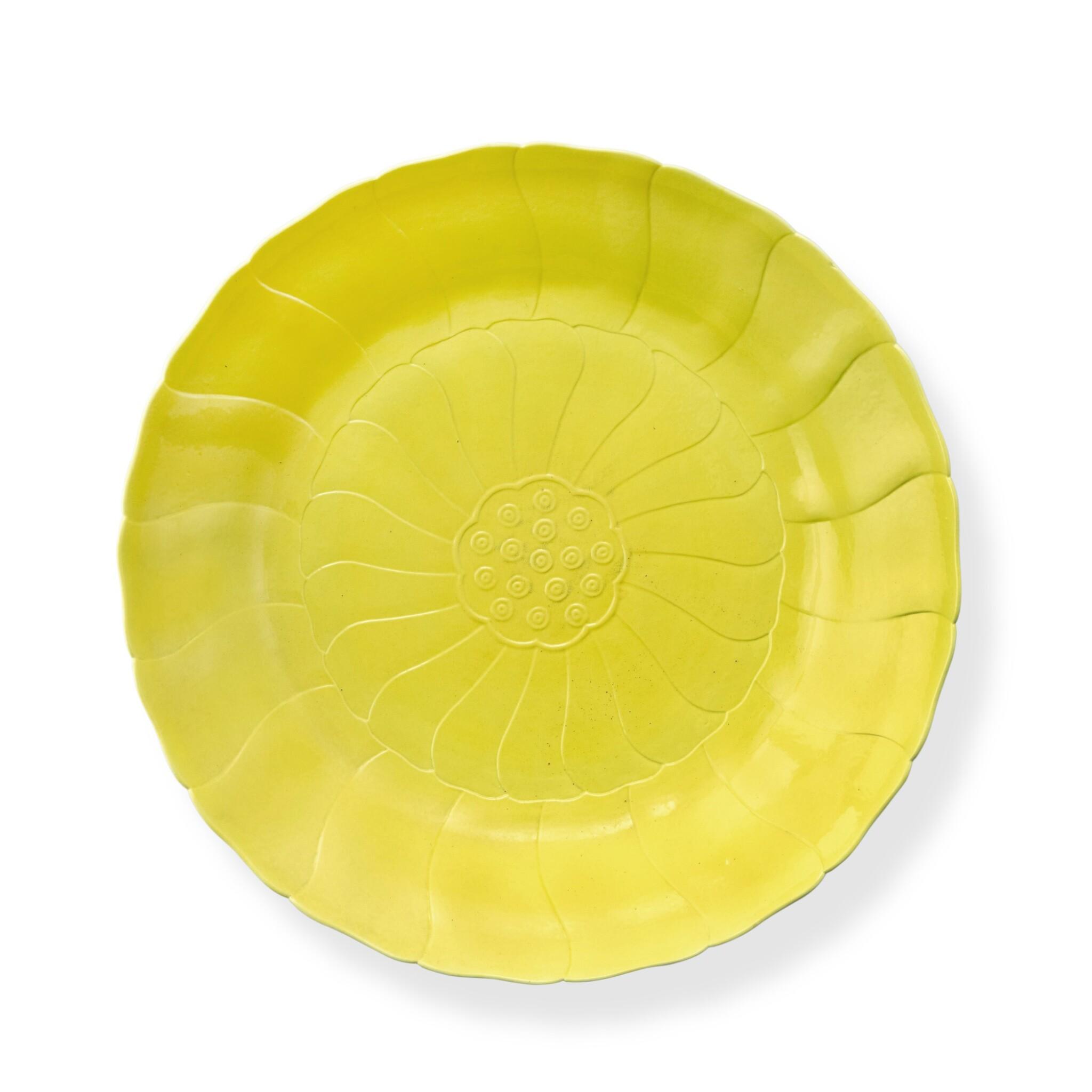 View full screen - View 1 of Lot 73. A rare molded lemon-yellow-enameled 'lotus' dish, Mark and period of Yongzheng   清雍正 檸檬黃釉蓮花式盤 《大清雍正年製》款.