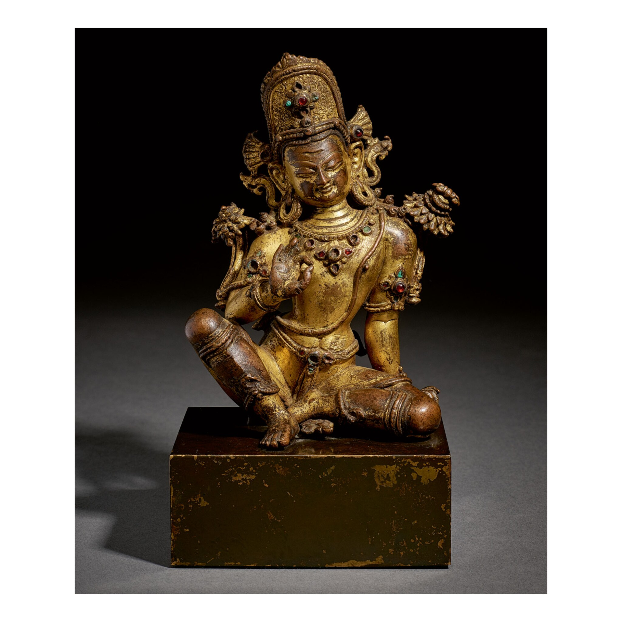View full screen - View 1 of Lot 321. A GILT COPPER FIGURE OF INDRA,  NEPAL, 15TH CENTURY.