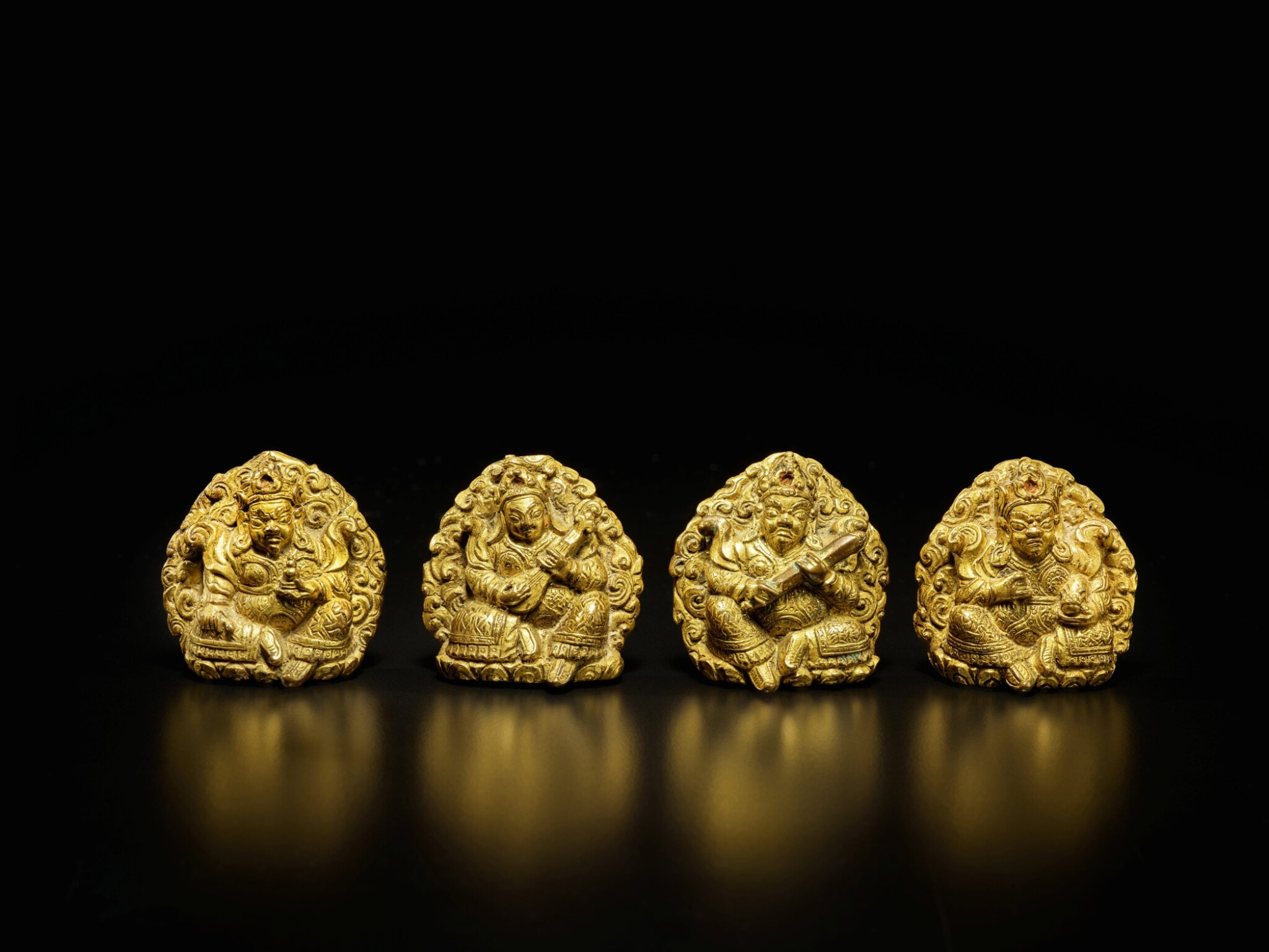 View full screen - View 1 of Lot 105. A set of four small gilt-bronze 'Guardian King' plaques, Tibet, 16th / 17th century | 西藏 十六 / 十七世紀 銅鎏金四大天王牌一套四件.