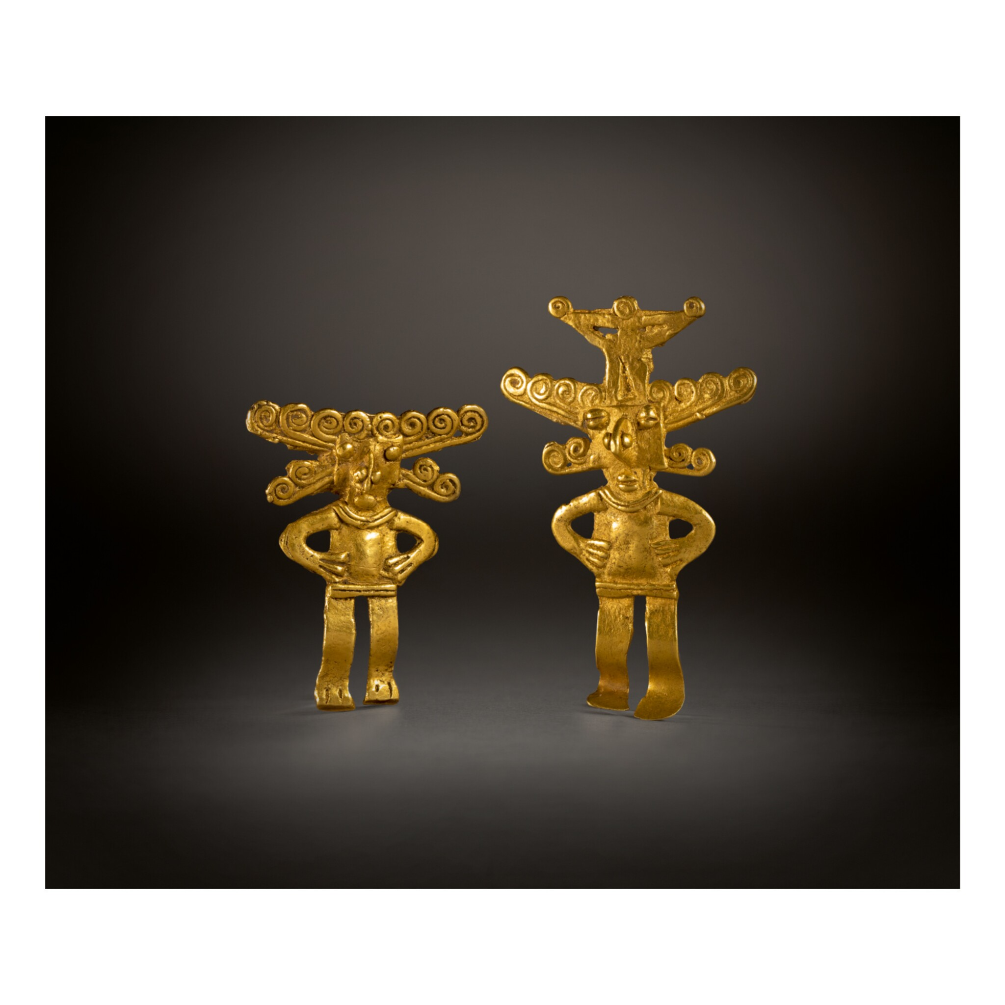 TWO COLOMBIAN GOLD FIGURAL ORNAMENTS, TOLIMA OR QUIMBAYA REGION CIRCA AD 500-1000
