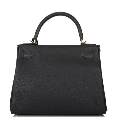 View 5. Thumbnail of Lot 52. HERMÈS   BLACK RETOURNE KELLY 28CM OF TOGO LEATHER WITH GOLD HARDWARE.