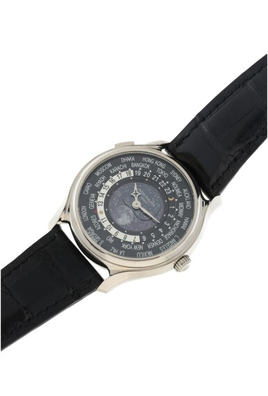 View 7. Thumbnail of Lot 61. REFERENCE 5575G-001 A LIMITED EDITION WHITE GOLD WORLDTIME WRISTWATCH WITH MOON PHASES, MADE TO COMMEMORATE THE 175TH ANNIVERSARY OF PATEK PHILIPPE, CIRCA 2015.