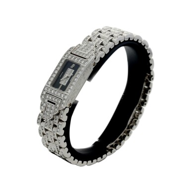 View 2. Thumbnail of Lot 74. A LADY'S WHITE GOLD AND DIAMOND SET BRACELET WATCH WITH ONYX AND DIAMOND-SET DIAL, CIRCA 2005.