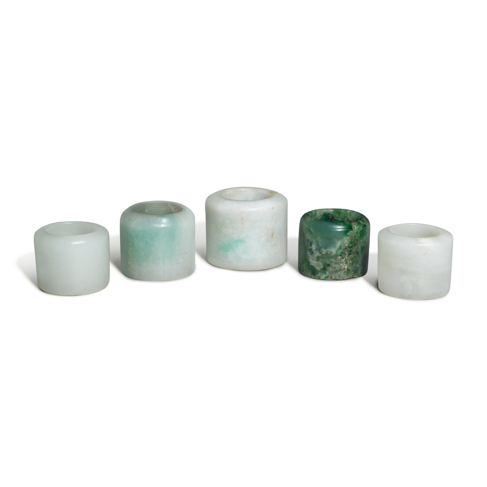 View full screen - View 1 of Lot 163. Five jade and jadeite archer's rings, 19th / 20th century.