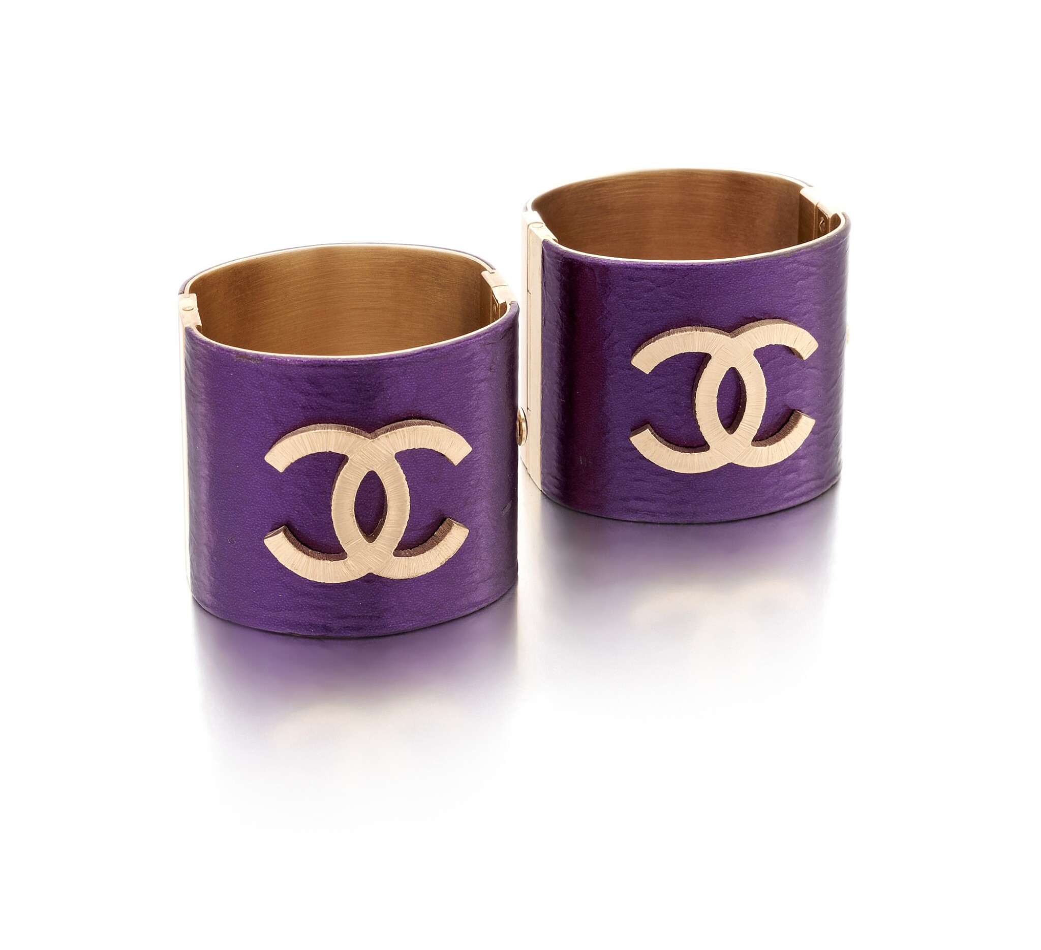 View full screen - View 1 of Lot 83. Pair of purple leather wide cuffs.